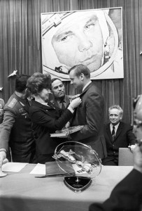 Valentina Tereshkova, presenting a badge to U.S. astronaut Neil Armstrong in memory of his visit to the Gagarin Cosmonaut Training Center in Star City. Photo Credit RIA Novosti